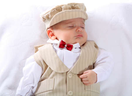 A portrait of a newborn baby boy in a blessing outfit.  photo