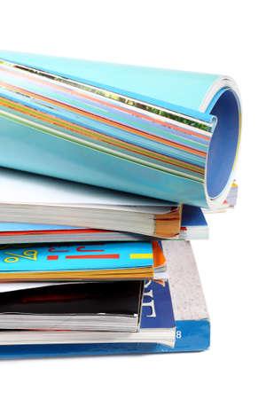 A pile of magazines on white background  Stock Photo - 8606368