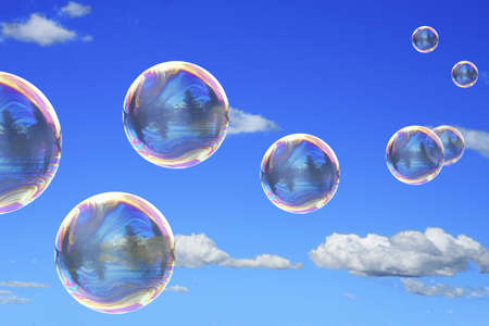 Soap bubbles on blue sky close up