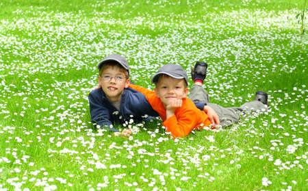 happy young brothers relaxing on a meadow  photo
