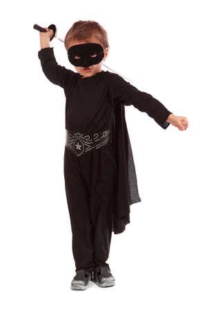 Young boy dressed in Zorro halloween costume  Standard-Bild