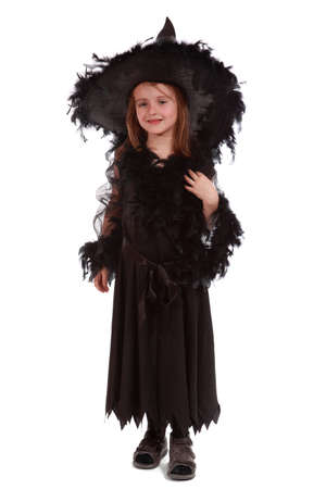 white robe: witch in black dress and hat standing on white