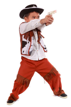 The little boy in a suit of the cowboy on a white background  Standard-Bild