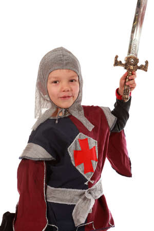 Young boy dressed as a Knight isolated on white  photo