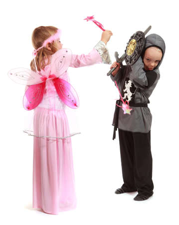 Young girl as magic fairy and boy dressed as a Knight isolated on white  Standard-Bild