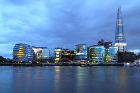 shard of glass: New London city hall at night , panoramic view from river   Editorial