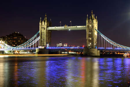 The iconic Tower Bridge of London lit up at night over the River Thames  Stock Photo