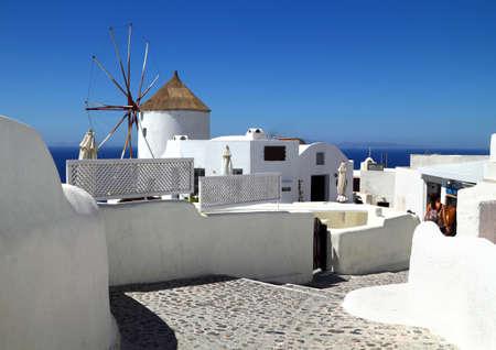 Windmill in Oia village on Santorini island, Greece  photo