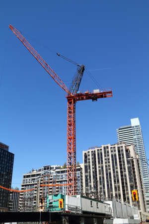 jib: high-rise building crane on top of building construction site