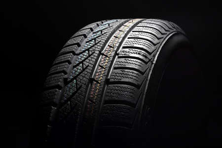 Close up of new winter tire on black