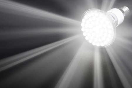 newest: Newest LED light bulb on black background