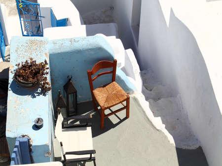 Two chairs on the Santorini island, Greece