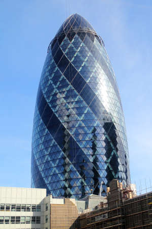 The modern glass buildings of the Swiss Re Gherkin in London, England