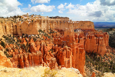 bryce: Bryce canyon panorama with snow in Winter with red rocks and blue sky.  Stock Photo
