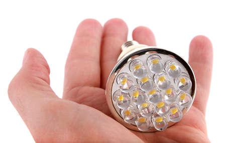 LED bulb in hand on white background Standard-Bild
