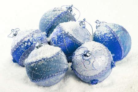 Blue christmas balls with snow - close up