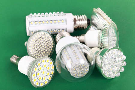 led lamp: Newest LED light bulb on green background Stock Photo