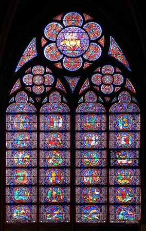 Paris, France - famous Notre Dame cathedral stained glass. UNESCO World Heritage Site.
