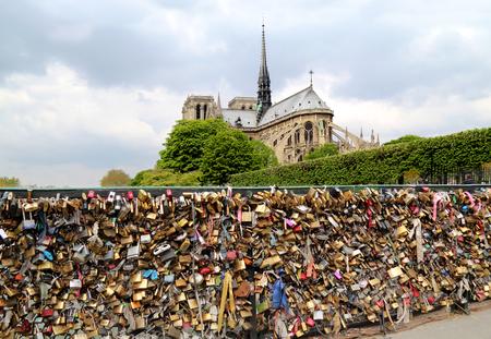 PARIS, FRANCE - APRIL 28: Pont de l Archeveche with love padlocks in Paris on April 28, 2013. The Pont de l'Archeveche is the narrowest road bridge in Paris and it was built in 1828