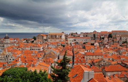 Old town in city of Dubrovnik with whirlwind at sea - Croatia