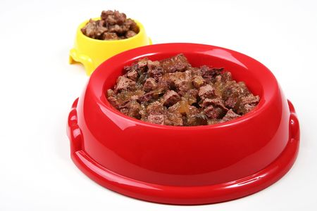 Two bowls of animal food photo
