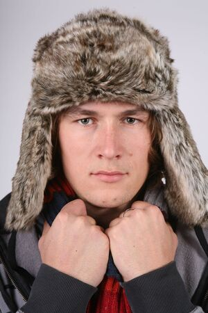 comfy: Young man in winter hat Stock Photo