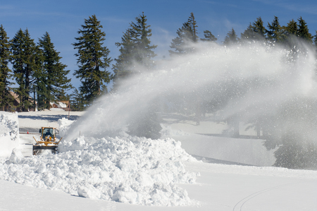oregon  snow: With 10-15 feet of snow a year, snow blowing is a full time activity to keep the roads clear for visitors at Crater Lake National Park. Oregon.