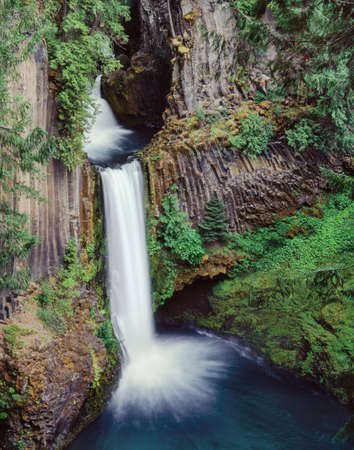 seldom: Toketee Falls, surrounded by basalt columns is located in southern Oregon near Crater Lake National Park, but is seldom visited.