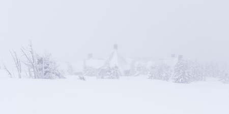 Timberline Lodge and snow covered trees on Mt Hood, Oregon during a snowstorm.