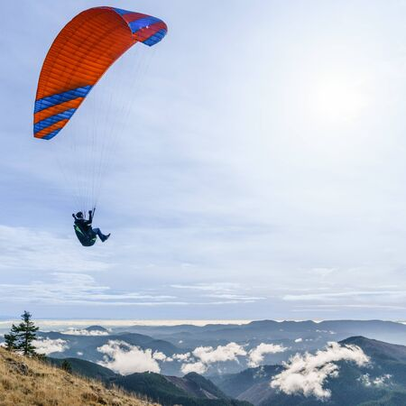 Paraglider above the clouds along the Oregon Coast Range. Stock Photo