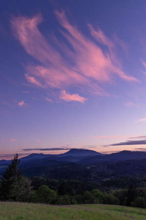 Sunset over Marys Peak as seen from Fitton Green Natural Area, Corvallis, Oregon. Stock Photo