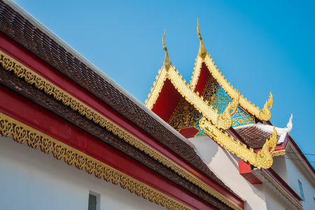 gloden: Beautiful roof tiles of temple in Chiang mai, Thailand