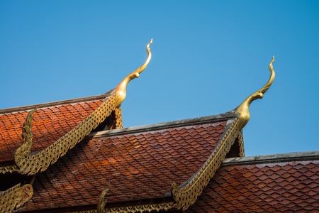 Beautiful roof tiles of temple in Chiang mai, Thailand photo