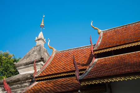 gloden: Beautiful roof tiles and white pagoda of temple in Chiang mai, Thailand blue sky Stock Photo