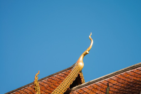 gloden: Beautiful roof tiles of temple in Chiang mai, Thailand blue sky Stock Photo