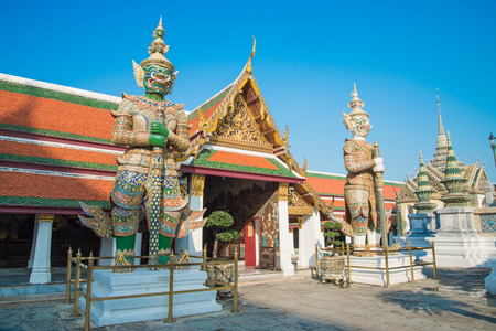 The two giant statue in Wat Pra Kaew, The Grand Palace, blue sky, Bangkok Thailand