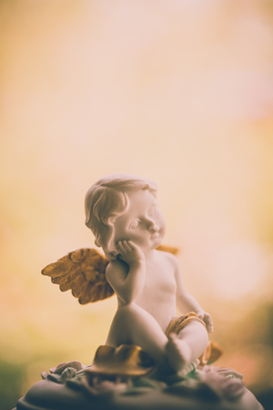 angel headstone: Angelic cupid statue - vintage retro effect style picture