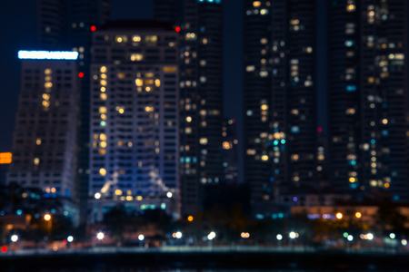 dark city: Abstract urban night light bokeh , defocused background