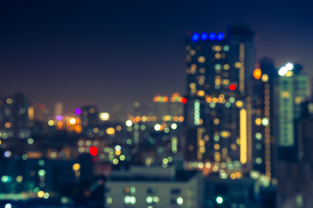 city by night: Abstract urban night light evening bokeh, defocused background