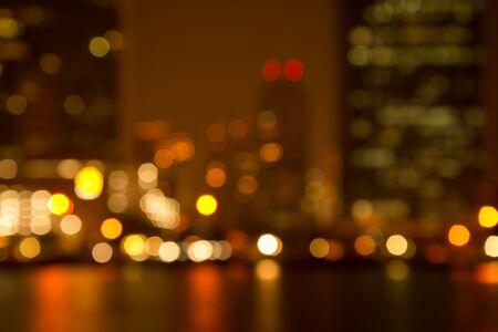 Abstract urban night light bokeh golden luxury, defocused background