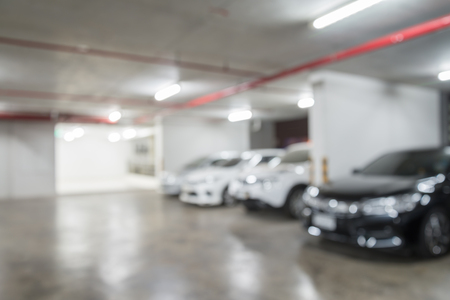 Abstract blurred indoors car parking at night background Stock Photo