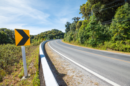 Traffic signs say the curve right direction on mountain highway, warning accident