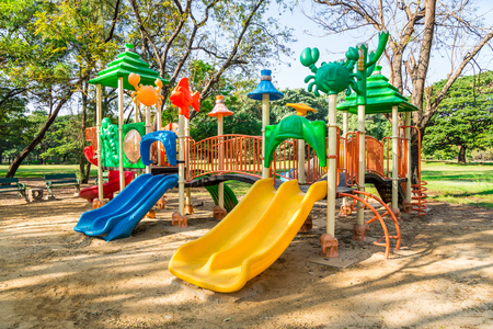 Outdoor children playground in green nature city park