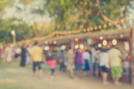 Blurred image of people in day market festival in city park background Archivio Fotografico