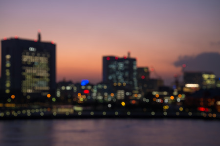 Defocused cityscape in twilight evening bokeh background, Yokohama Japan Standard-Bild - 103187695