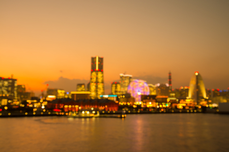 Defocused cityscape in twilight evening bokeh background, Yokohama Japan - Golden luxury tone