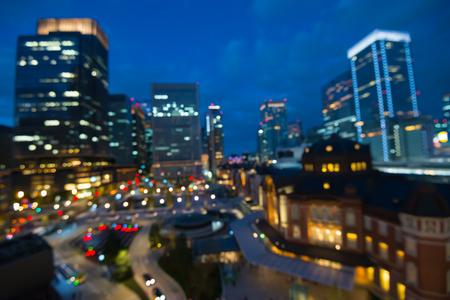 Defocused cityscape in twilight evening bokeh background, Tokyo station Japan Standard-Bild - 103187715