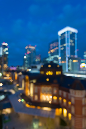 Defocused cityscape in twilight evening bokeh background, Tokyo station Japan Standard-Bild - 103187718