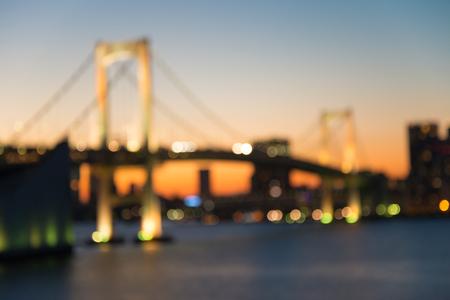 Defocused rainbow bridge cityscape in twilight evening bokeh background, Odaiba Tokyo Japan Standard-Bild - 103187747