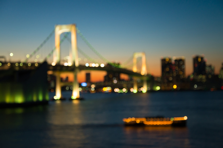 Defocused rainbow bridge cityscape in twilight evening bokeh background, Odaiba Tokyo Japan 版權商用圖片